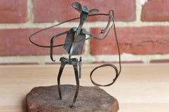 Metal Lassoing Cowboy Sculpture