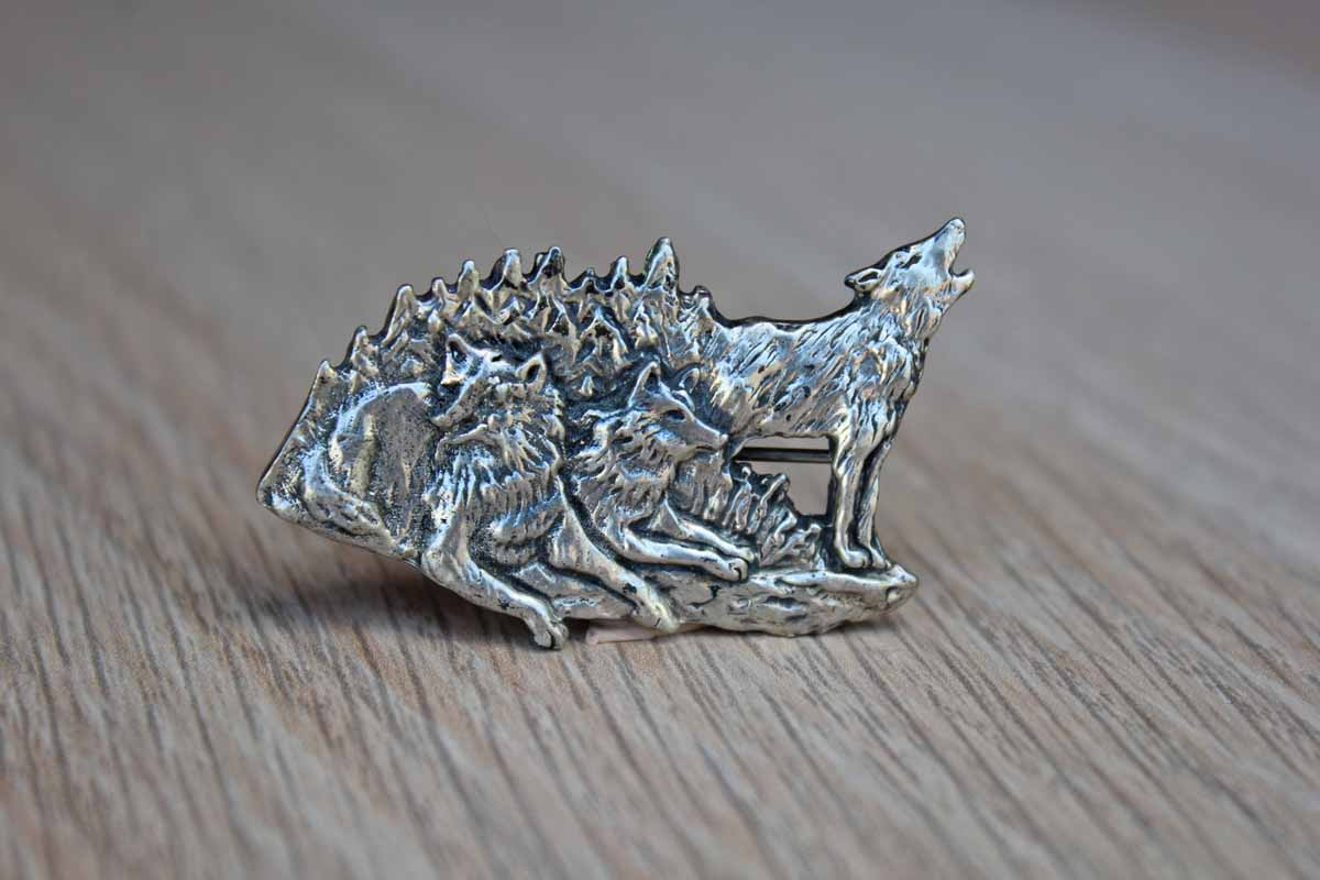 Silver Metal Brooch with Etched Rendering of a Howling Wolf with His Pack