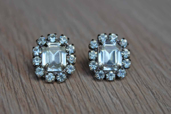 Emerald Cut Silver Rhinestone Pierced Earrings with Round Cut Rhinestone Accents