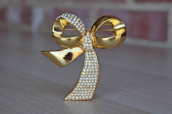 Large Gold Tone Ribbon Brooch with Silver Inset Rhinestones