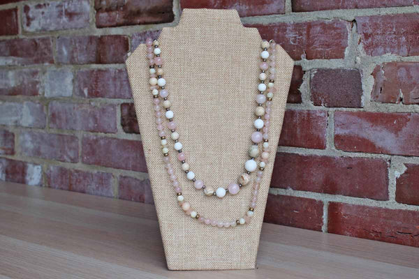 A Pair of Polished Pinkish-Purple and Cream Stone Bead Necklaces