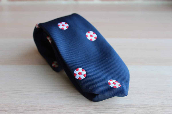 Pintail Polyester Necktie Decorated with Red and White Soccer Balls on Navy Blue Background