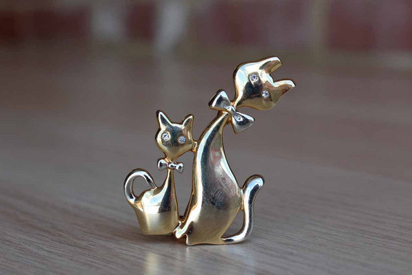 Brooch with Two Gold Tone Cats Wearing Silver Bow Ties and Silver Rhinestone Eyes