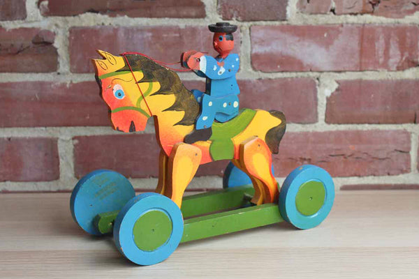 Hand Painted Man Riding a Horse Toy