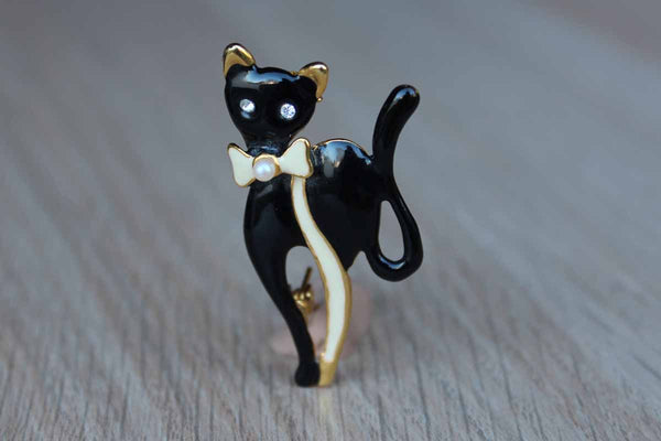Black Enamel Cat Brooch with Ivory Colored Pearl Bow and Rhinestone Eyes