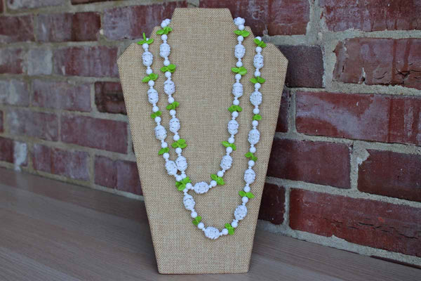 Long Single Strand Necklace Decorated with Plastic White Flowers and Green Leaves, Made in Hong Kong
