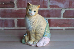 Mary Lake-Thompson for Silvestri (Taiwan) Porcelain Ginger Cat Wrapped in Patchwork Quilt Figurine