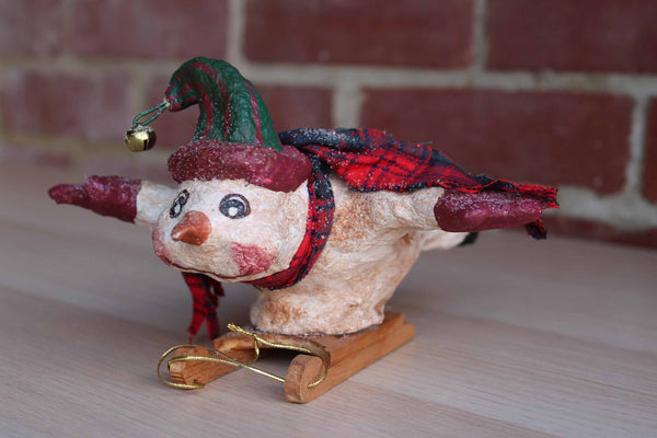 Handmade Snowman on a Sled Decorative Ornament