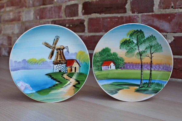 Hand Painted Porcelain Plates Featuring Colorful Landscape and Water Scenes