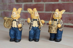 Three Faux Wood Painting Rabbits Playing Instruments