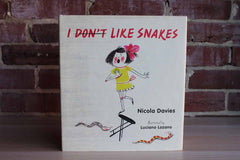 I Don't Like Snakes by Nicola Davies Illustrated by Luciano Lozano