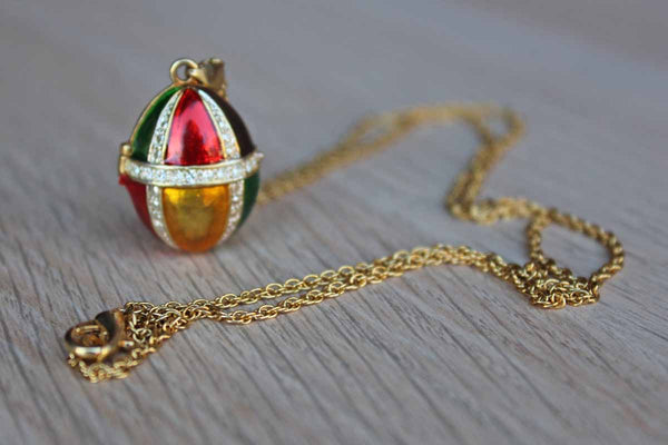 Gold Tone Colorfully Enameled Egg Locket on a Gold Chain