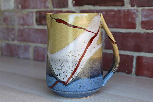 Handmade Handled Pitcher with Abstract Nature-Inspired Design