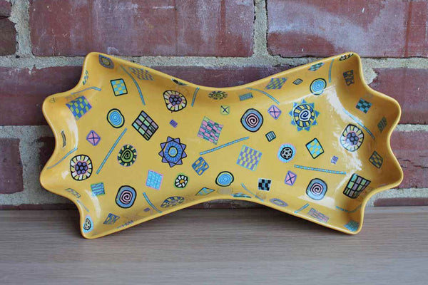 Bow Tie-Shaped Ceramic Dish with Colorful Millefiori-Style Shapes and Designs