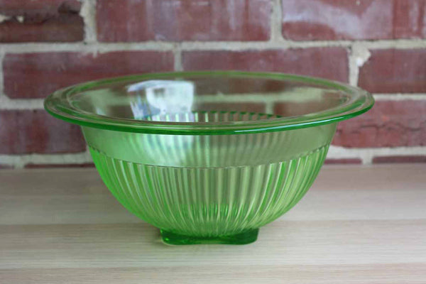 Large Green Vaseline Glass Bowl with Ridged Sides and Prominent Rim