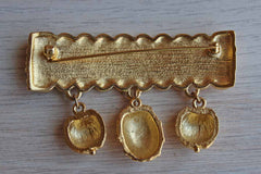 Gold Tone Brooch Shaped Like Trim with Tassels