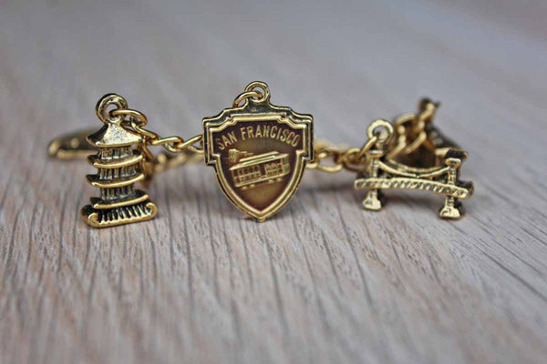 Children's Size Gold Tone Charm Bracelet Featuring San Francisco Points of Interest