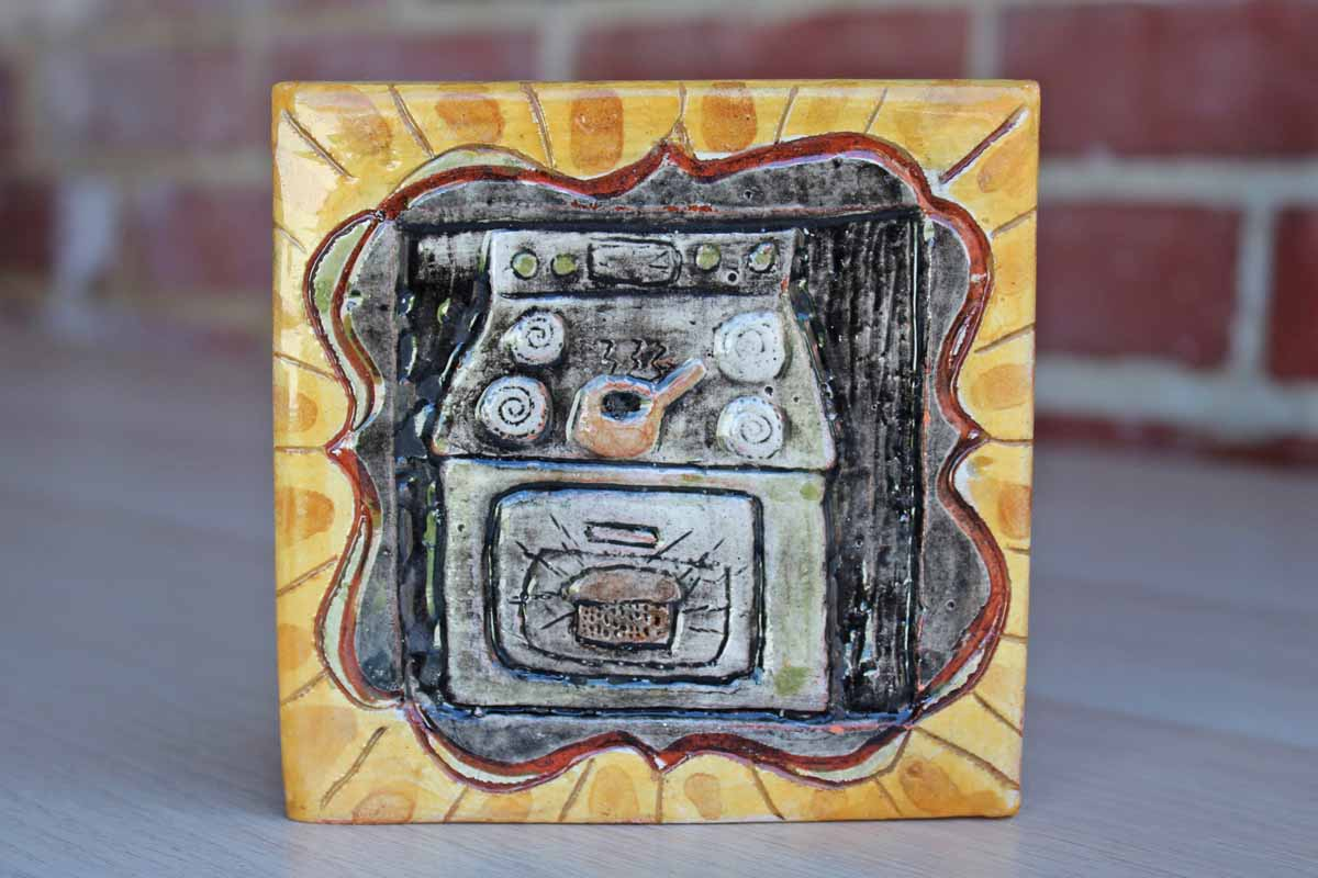 Handmade Ceramic Tile Decorated with a Stove