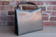 Gray Leather Handbag with Braided Snap Closure
