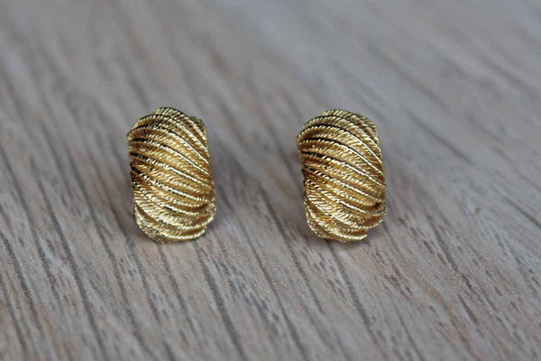 Gold Tone Pierced Earrings with Curved Shape and Ridged Details