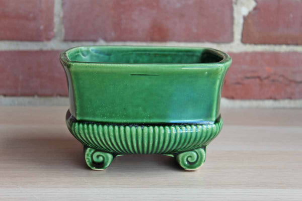 Glossy Avocado Green Footed Planter with Elegant Lines