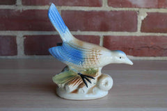 Ceramic Figurine of a Bird Perched on a Branch
