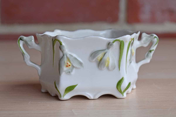 Little Porcelain Handled Sugar Bowl with Embossed Flowers