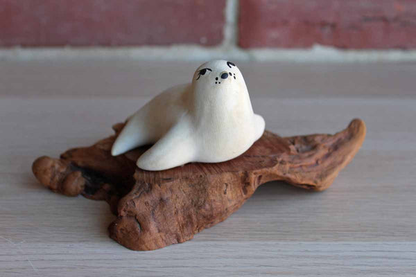 Carved Wood Seal on Driftwood Base