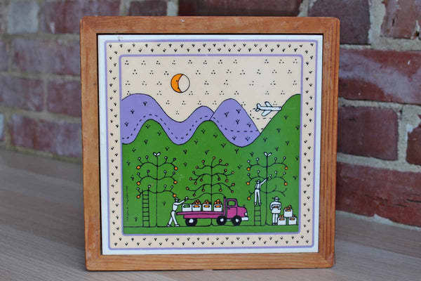 Ceramic Tile Decorated with Apple Pickers Loading a Red Wagon with Mountains and an Airplane