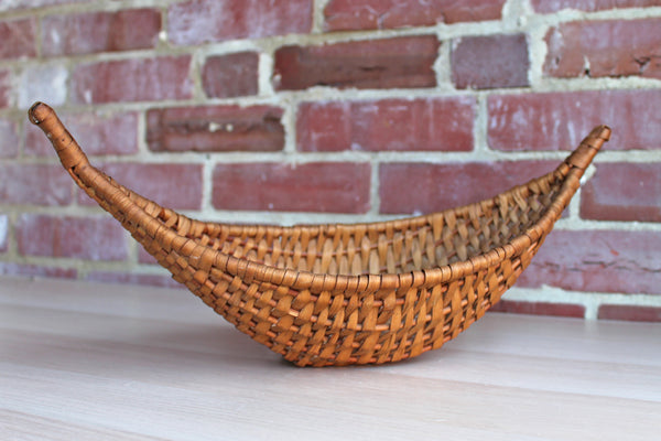Rustic Canoe-Shaped Handmade Basket with Naturally Aged Finish