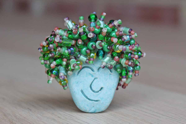 Fun Handmade Brooch of a Ceramic Face with Wild Beaded Hair