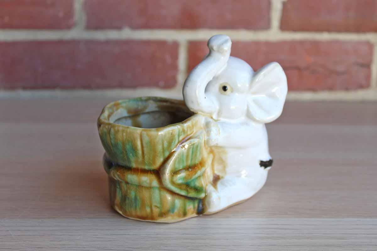 White Ceramic Elephant Holding a Bucket Planter or Catchall