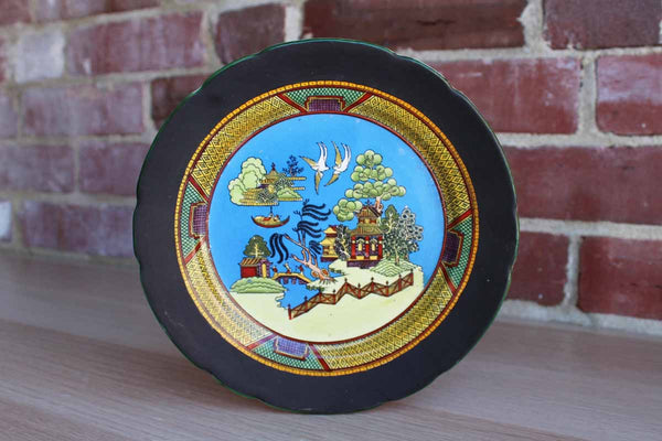 Delicate China Plate Decorated with Landscape and House Scenes and a Matte Black Border