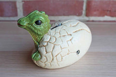 Hatching Baby Dinosaur Cast Iron Coin Bank