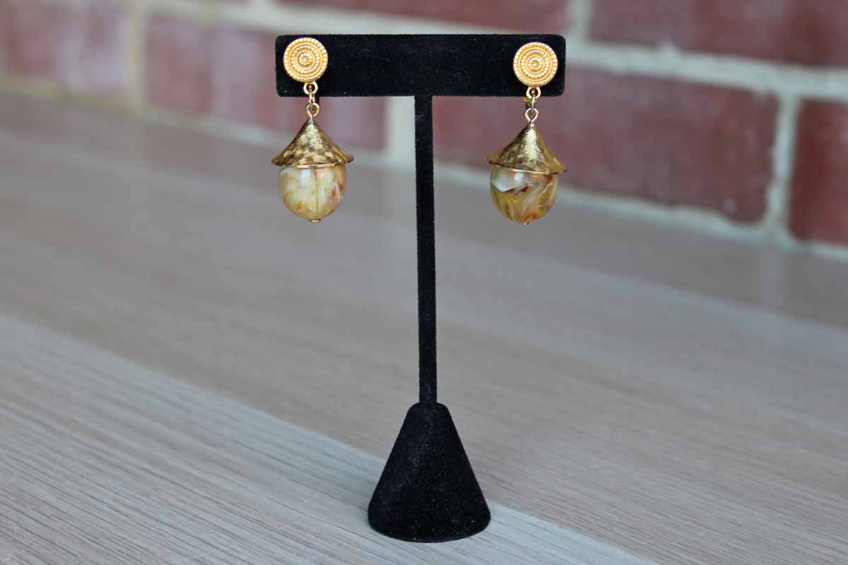 Trifari (USA) Gold Tone Pagoda Style Clip On Earrings with Caramel Swirled Plastic Stones