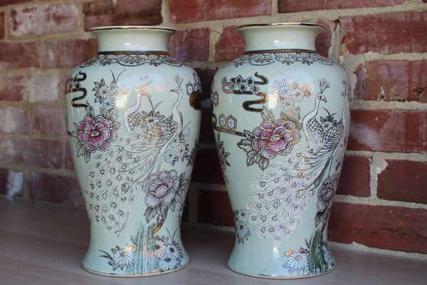 Baluster Shaped Moriaged Vases Depicting Lilac, Gold and White Peacocks and Flowers Over an Off White Background