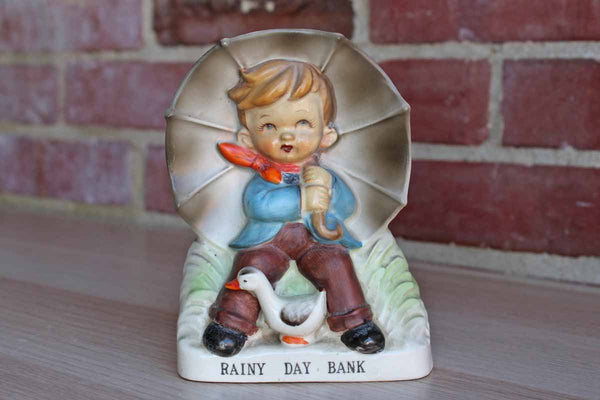 "Ceramic Boy Under an Umbrella ""Rainy Day Bank"""