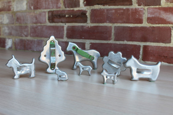Aluminum Cookie Cutters Shaped like Animals and Tree and Flower