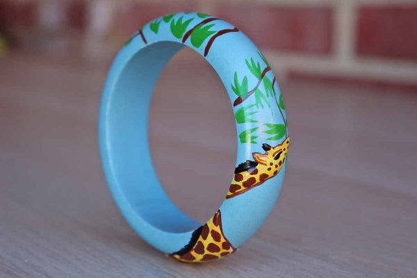 Wood Bracelet with Hand-Painted Giraffe Eating Tree Leaves