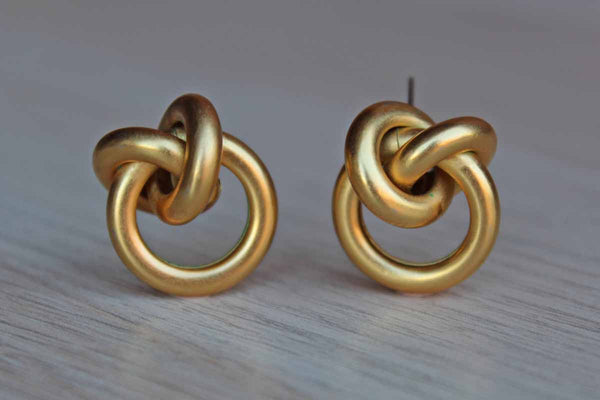 Gold Tone Pierced Earrings Shaped Like Knots