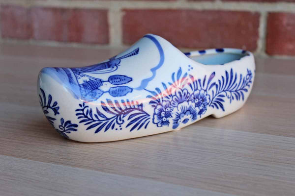 Blue and White Ceramic Dutch Shoe Decorated with Flowers and a Windmill Scene