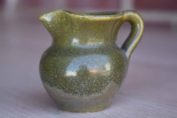 Miniature Green Stoneware Handled Pitcher