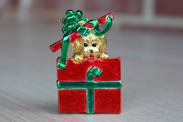 AJC Jewelry (New York, USA) Puppy Popping Out of a Red Present Brooch