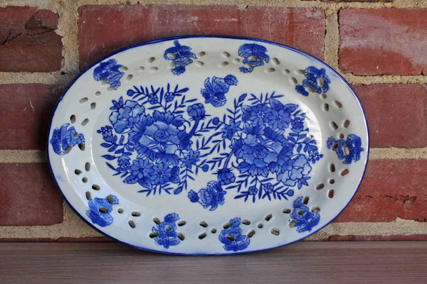 Ceramic Blue and White Oval Dish with Flowers and Cut Out Designs on the Rim