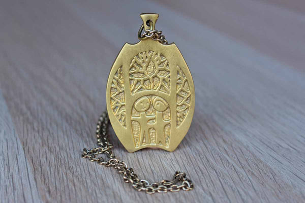 Brass Pendant Necklace with Two-Sided Abstract Design of Two People Standing Amidst Trees