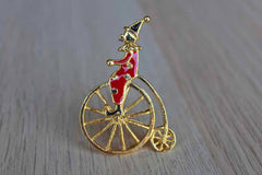 Clown Riding a Penny-Farthing Bicycle Brooch