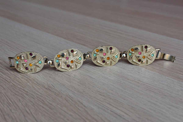 Sarah Coventry Gold Tone Linked Bracelet Decorated with Colorful Rhinestones and Geometric Patterns