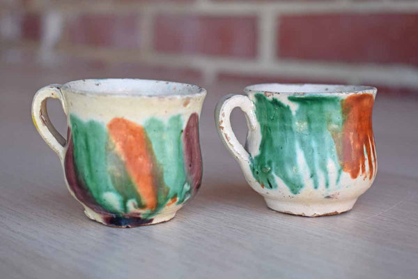 Two Small Primitive Ceramic Orange and Green Glazed Mugs