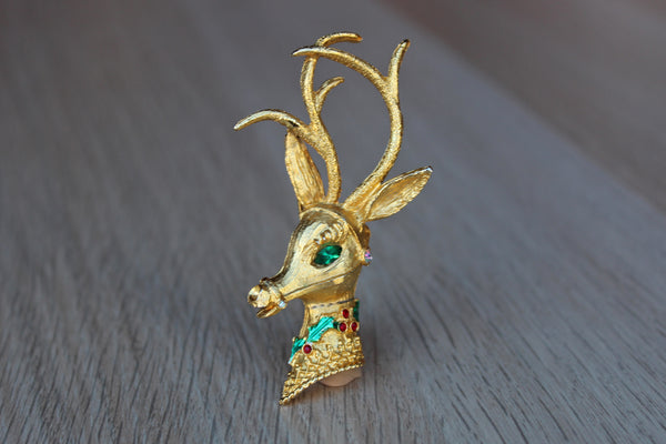 Gold Tone Reindeer Brooch Decorated with Glistening Rhinestones
