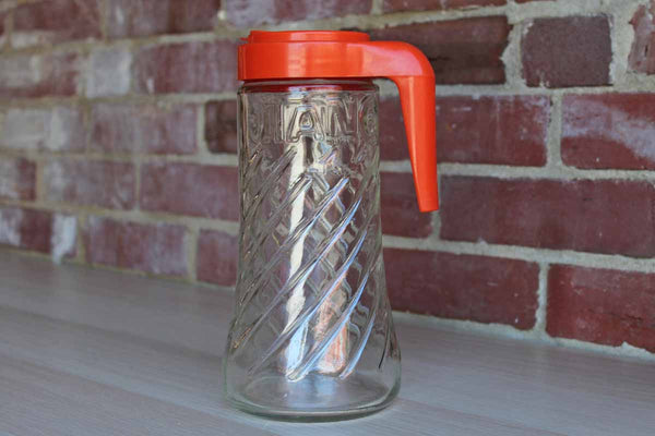 "Anchor Hocking (USA) 1 Quart Glass ""Tang"" Refrigerator Pitcher with Orange Lid and Flip Top Spout"